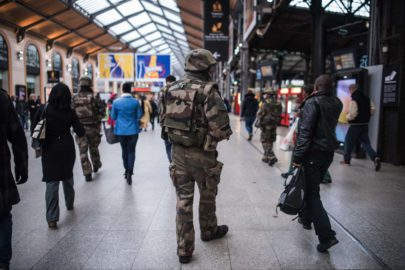 A French soldier patrols at Gare Saint Lazare train station in Paris, Saturday, Nov. 15, 2015. French President Francois Hollande vowed to attack Islamic State without mercy as the jihadist group admitted responsibility Saturday for orchestrating the deadliest attacks inflicted on France since World War II. (AP Photo/Kamil Zihnioglu)/ZIH102/225136091837/1511141246